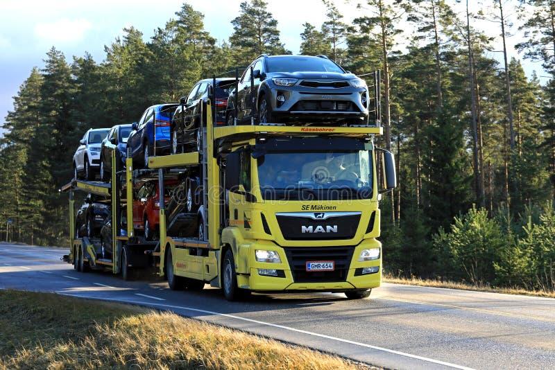Yellow MAN TGS 18.420 Car Carrier Hauls New Cars stock image