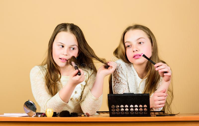 Salon and beauty treatment. Just like playing with makeup. Children little girls choose cosmetics. Makeup store stock photo