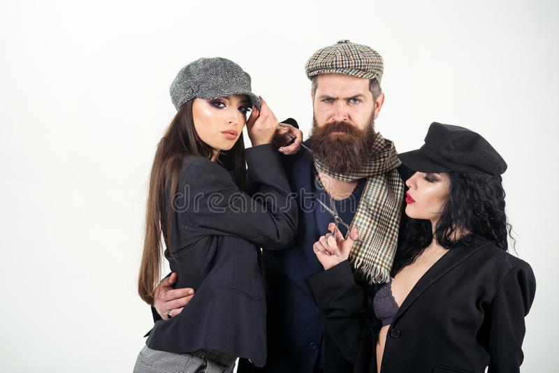 Salon concept. Bearded man hug women with barber tools, salon. Shaving or barber salon. Salon for real men. Create your royalty free stock photography