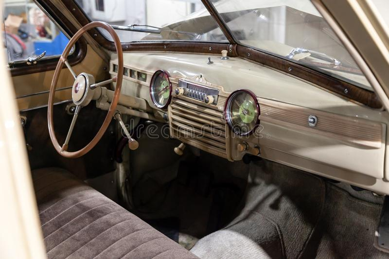 Salon interior of soviet retro car gaz m20 with vintage steering wheel and soft seats in good condition stock photography