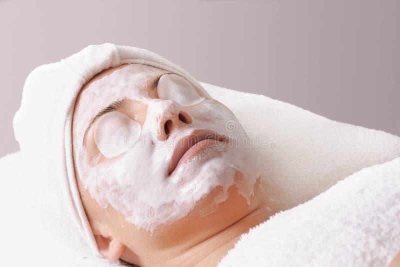 Salon Treatment. Woman receives a salon treatment stock photo