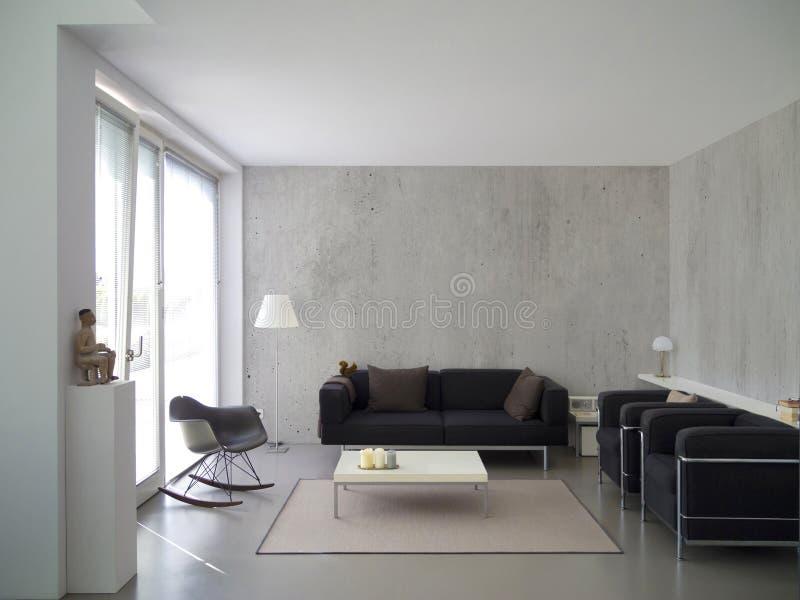 Salone moderno con il muro di cemento fotografie stock libere da diritti