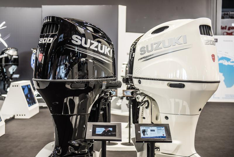 Suzuki Four Stroke Outboard Motor. Salone Nautico in Genova, Italy 2017. On display big modern, Suzuki Four Stroke last generation white and powerful speed boat stock photography