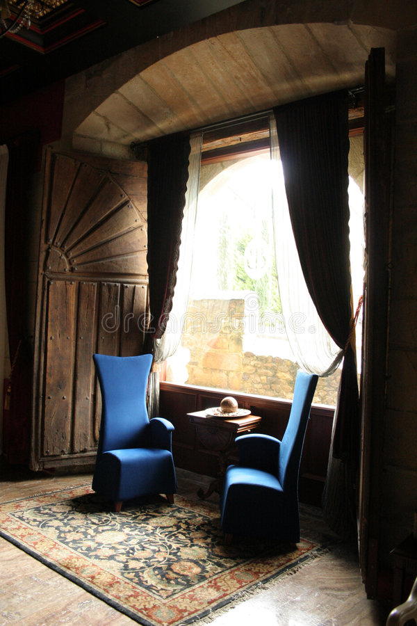 Saloon. With two arm chairs beside a big window in a palace Sonares in Villacariedo, Cantabria stock photography