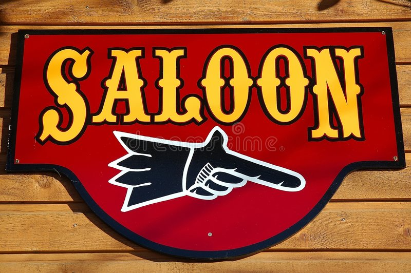 Saloon sign. An old saloon sign attached to a western building royalty free stock photography