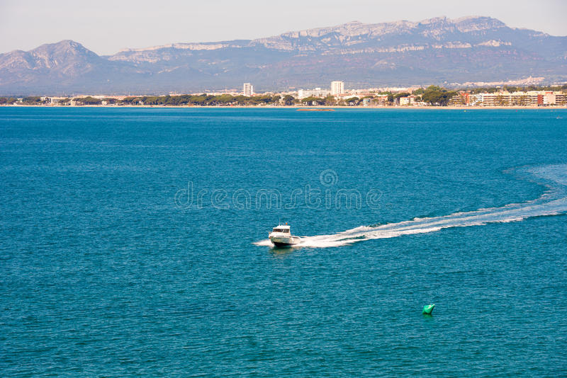 SALOU, TARRAGONA, SPAIN - APRIL 24, 2017: White yacht on mediterranean sea, Costa Dorada, Tarragona, Catalanya, Spain. Copy space. stock photos