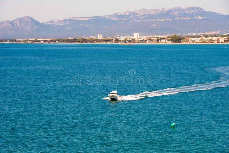 SALOU, TARRAGONA, SPAIN - APRIL 24, 2017: White yacht on mediterranean sea, Costa Dorada, Tarragona, Catalanya, Spain. Copy space. SALOU, TARRAGONA, SPAIN stock photos