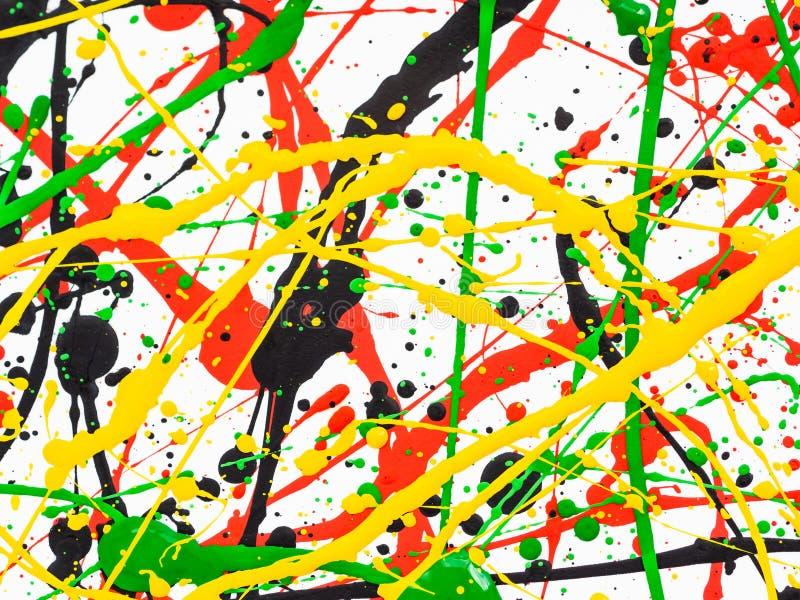 Salpicado de la pintura negra roja verde amarilla derramada fotografía de archivo libre de regalías