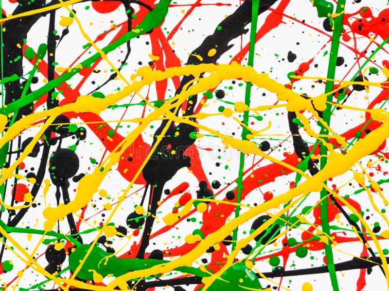 Salpicado de la pintura negra roja verde amarilla derramada fotografía de archivo