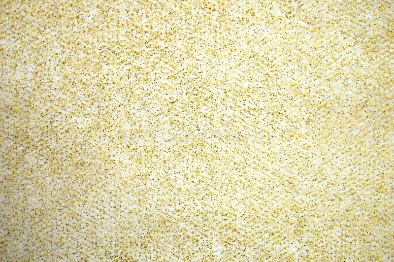 Salpicos do brilho do ouro no fundo branco fotografia de stock