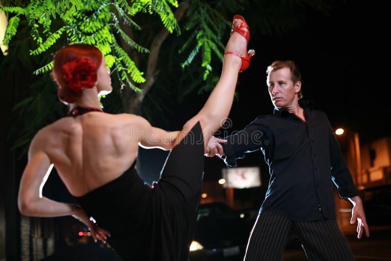 Salsa dance. Couple dancing hot latin dance on a street at night