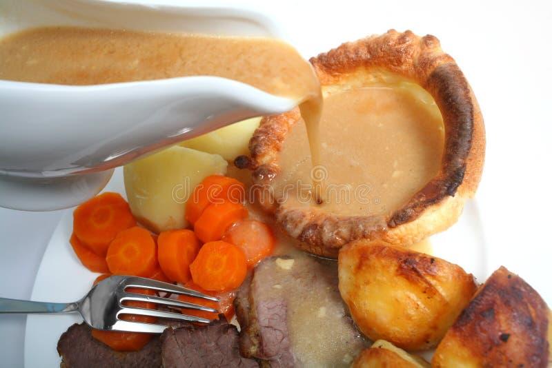 Salsa de colada en la carne de vaca de carne asada foto de archivo libre de regalías