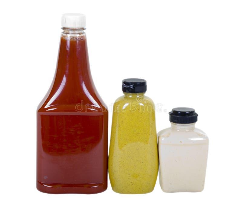 Salsa de tomate, mostaza y rábano picante en botellas foto de archivo libre de regalías