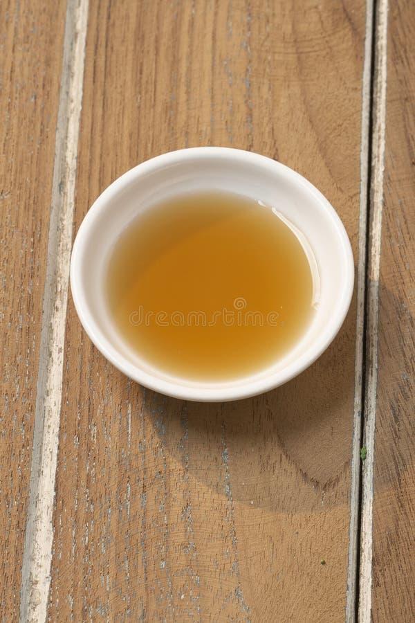 Salsa di pesce su una tazza fotografia stock