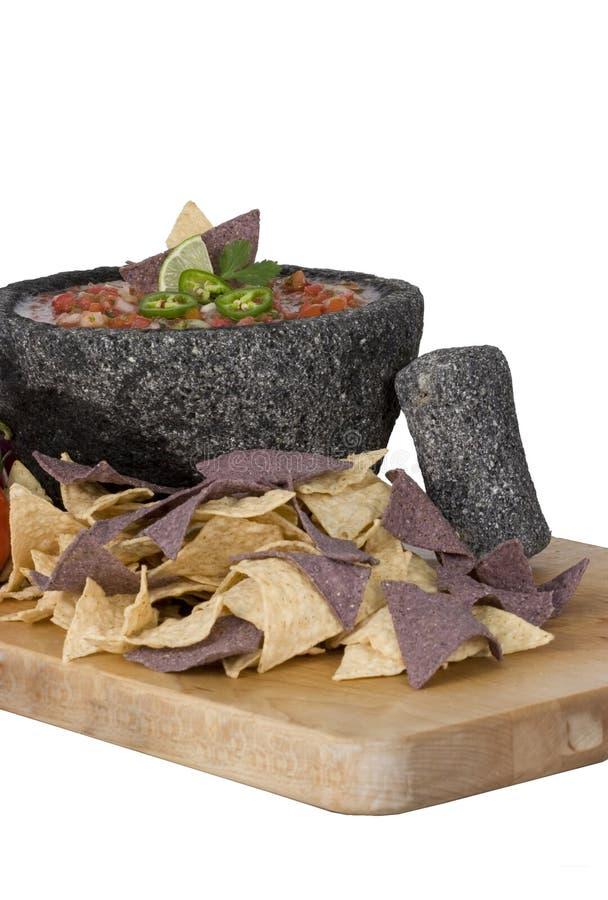 Salsa in Molcajete mit sicheren Wertpapieren lizenzfreie stockfotos