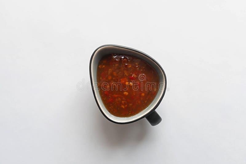 Salsa roja en un fondo blanco foto de archivo