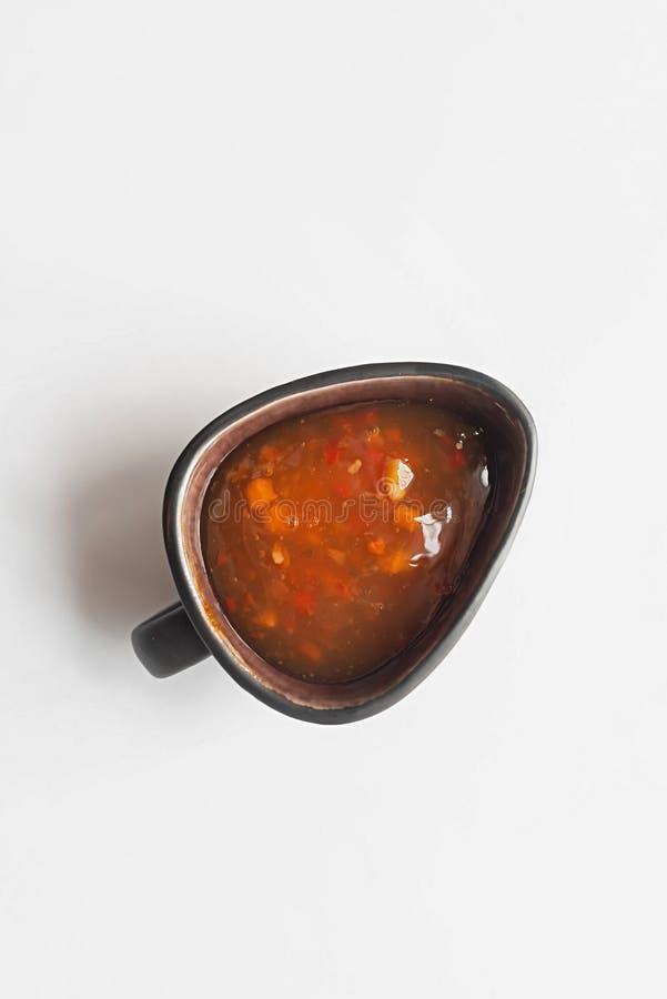Salsa roja en un fondo blanco imágenes de archivo libres de regalías