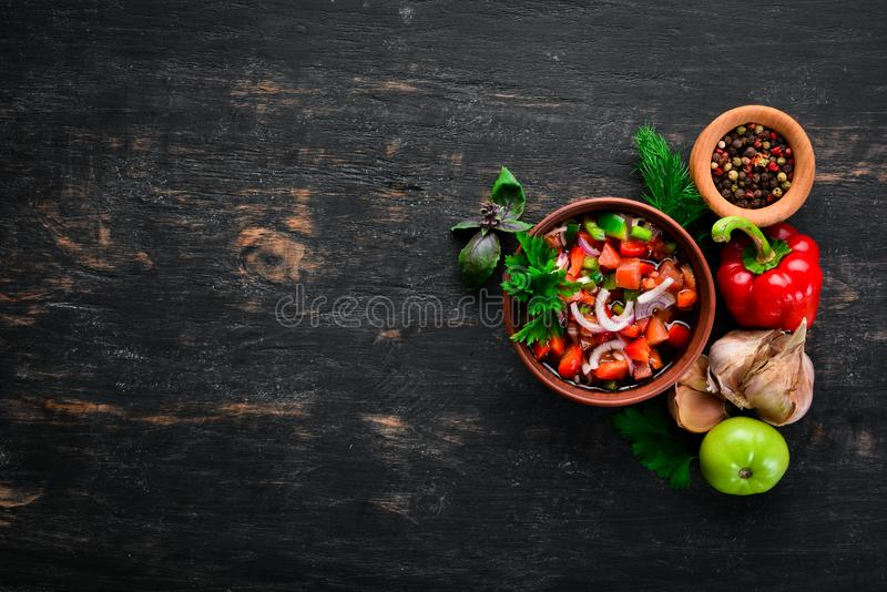 Salsa sauce and ingredients. Latin American Mexican Traditional Sauce. Top view. On a black background. Free space for text stock photography