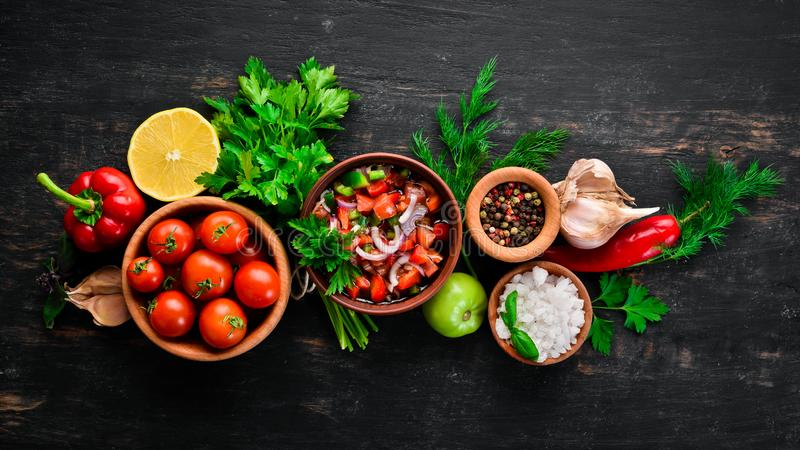 Salsa sauce and ingredients. Latin American Mexican Traditional Sauce. Top view. On a black background. Free space for text royalty free stock images