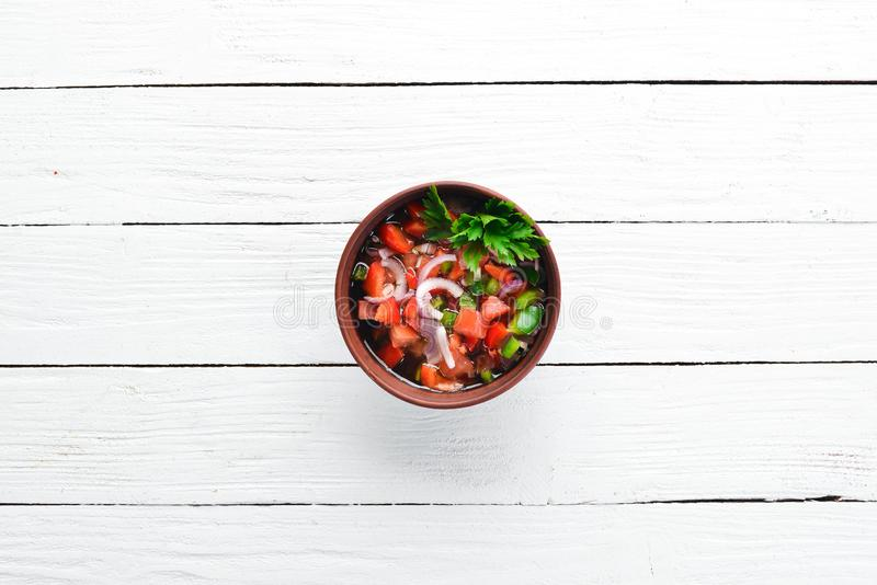 Salsa sauce and ingredients. Latin American Mexican Traditional Sauce. Top view. On a white wooden background. Free space for text royalty free stock photography