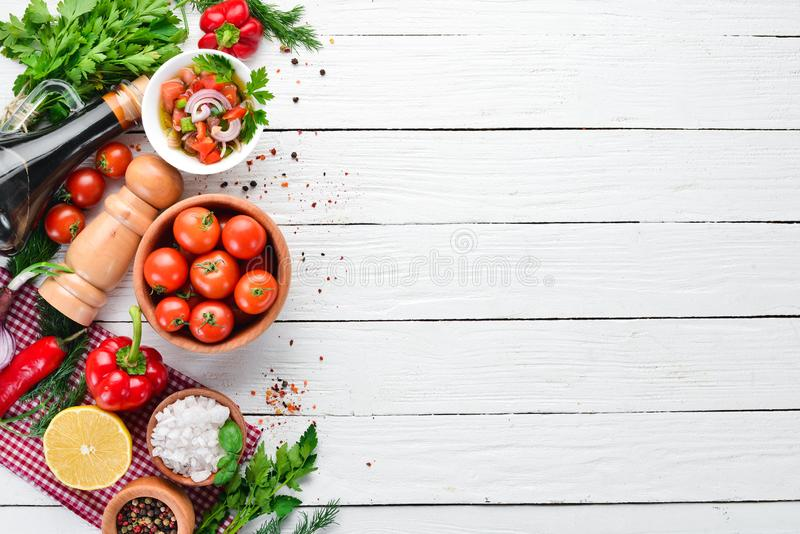 Salsa sauce and ingredients. Latin American Mexican Traditional Sauce. Top view. On a white wooden background. Free space for text stock photography