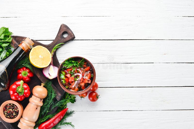 Salsa sauce and ingredients. Latin American Mexican Traditional Sauce. Top view. On a white wooden background. Free space for text royalty free stock image