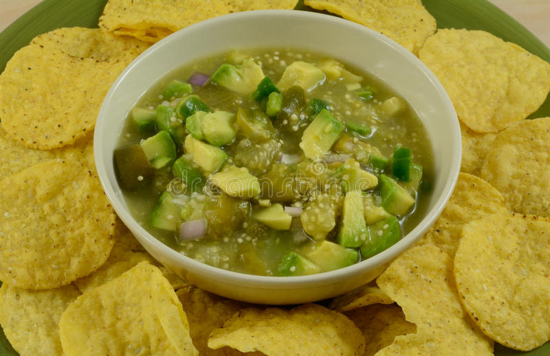 Salsa verde guacamole mixture with chips royalty free stock images