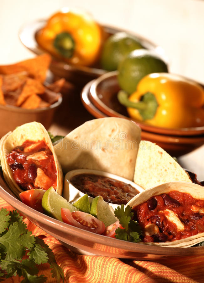 SALSA WRAPS WITH CHILLI RELISH. FRESHLY PREPARED SALSA WRAPS WITH CHILLI RELISH WITH FRESH WHOLE PEPPERS AND CHIPS IN BACKGROUND royalty free stock photos