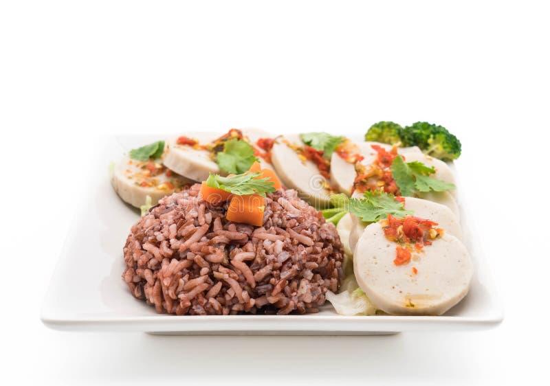 salsiccia di maiale conservata e salsa piccante con il riso della bacca immagine stock