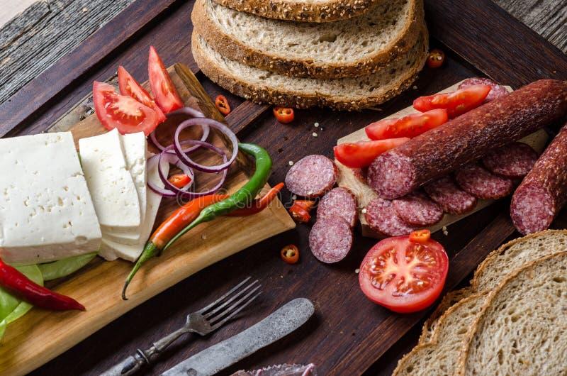 Salsiccia e formaggio fotografie stock