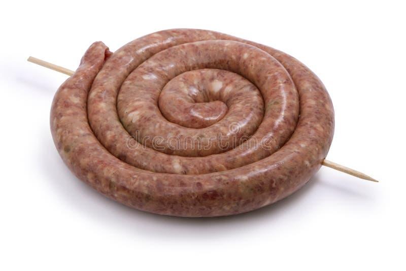 Salsiccia a spirale della carne grezza immagini stock libere da diritti