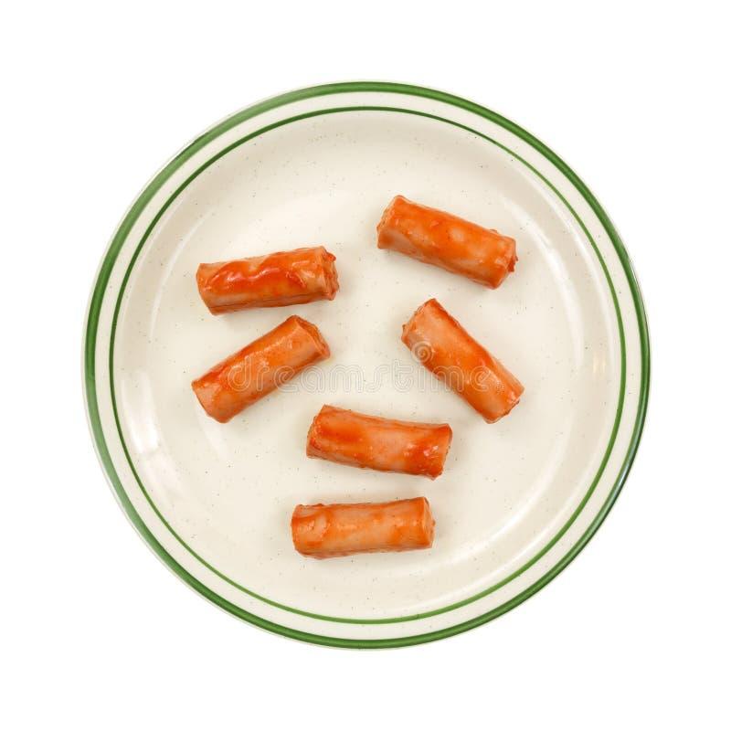 Salsiccie di boccone sul piatto fotografia stock