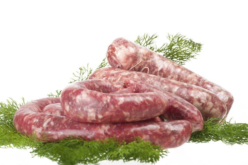 Salsiccie fresche della carne cruda fotografia stock