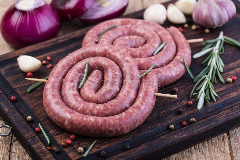 Salsicha de carne de porco crua fotografia de stock