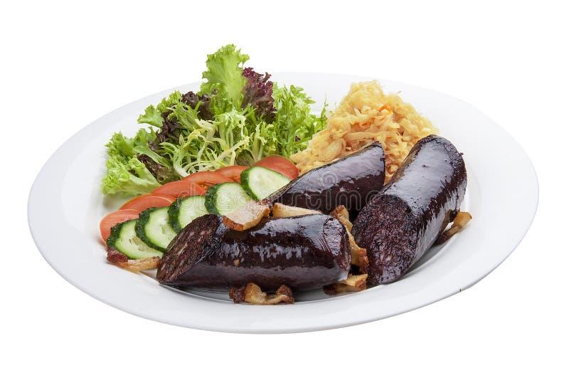 Salsicha de sangue com vegetais e salada Em uma placa branca fotografia de stock