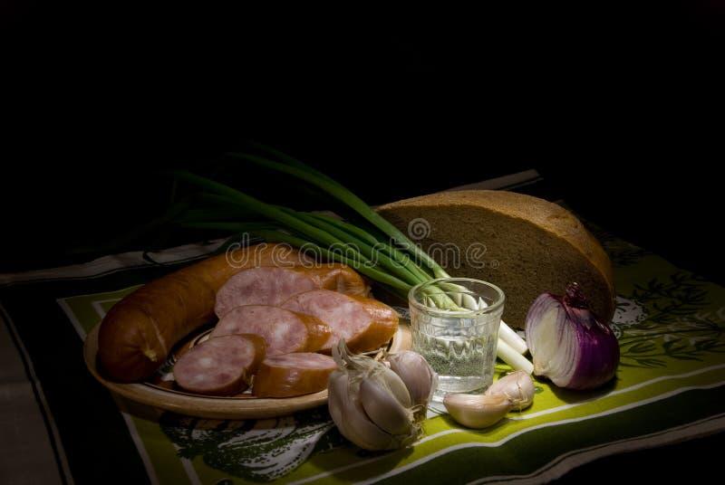 Salsicha e pão imagem de stock