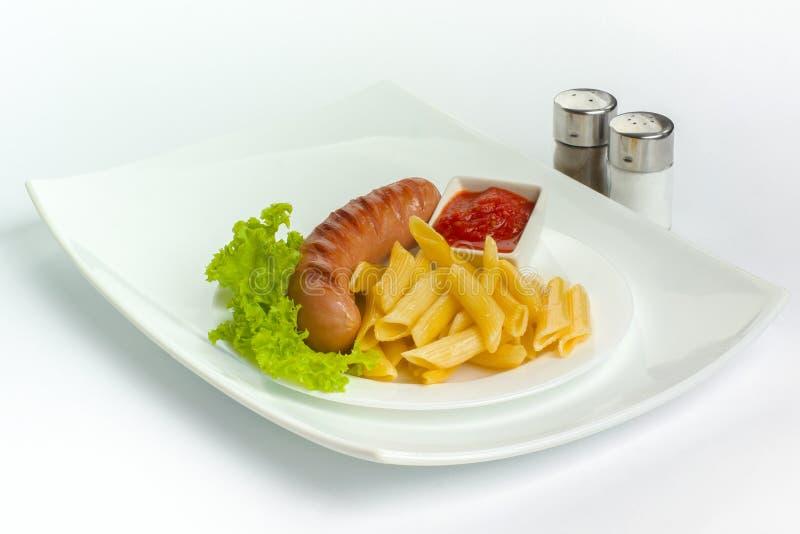 Salsichas de carne de porco com massa fotografia de stock royalty free