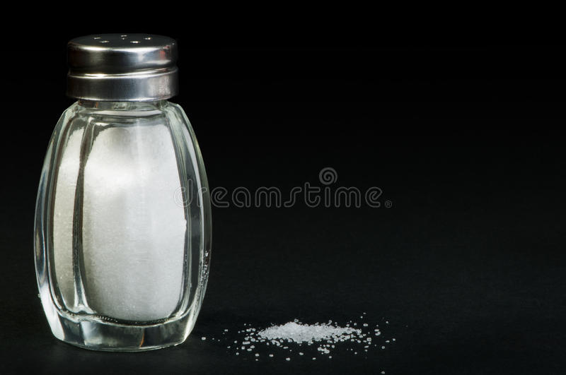 Salt on black background stock photos