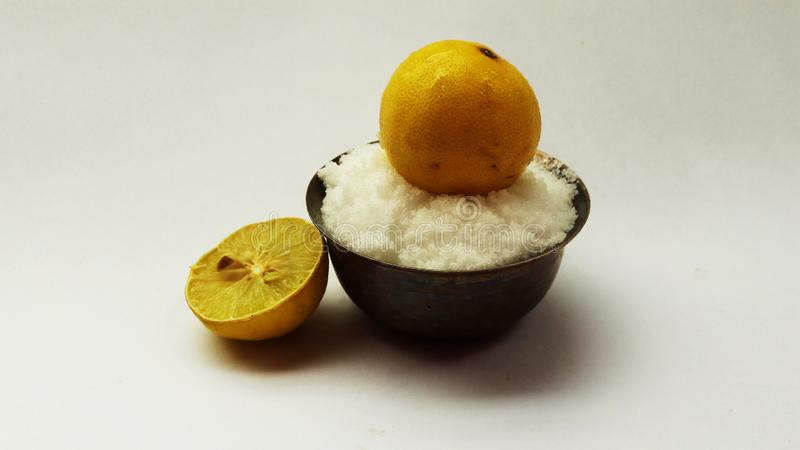 Salt in bowl and lemon on it isolated on with background. Alternative, ripe, nature, science, summer, growth, industry, plant, lifestyle, fuel, scene, snack stock images