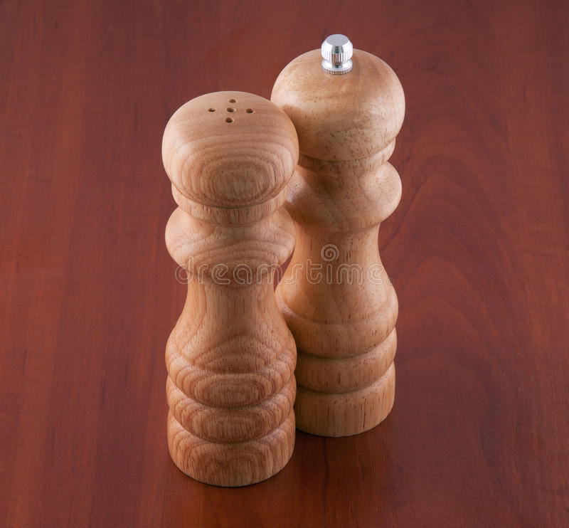 Salt-cellar and pepper-box on a table royalty free stock photography