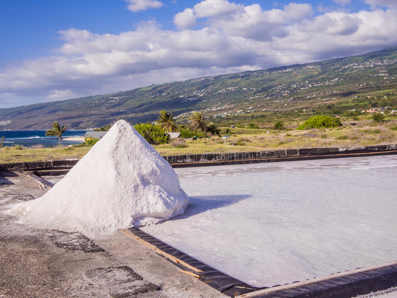 Salt evaporation pond and pile of salt royalty free stock photo