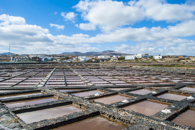 Salt evaporation pond. The seawater or brine is fed into large ponds and water is drawn out through natural evaporation which allows the salt to be subsequently stock photos