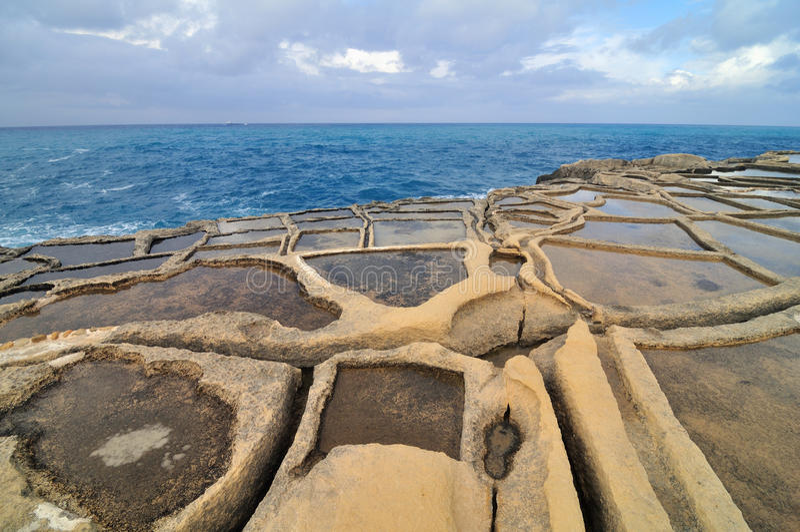 Salt evaporation ponds. Off the coast of Gozo, Malta stock images