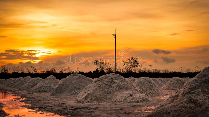 Salt farm in the morning with sunrise sky. Organic sea salt. Evaporation and crystallization of sea water. Raw material of salt. Industrial. Sodium Chloride royalty free stock photography