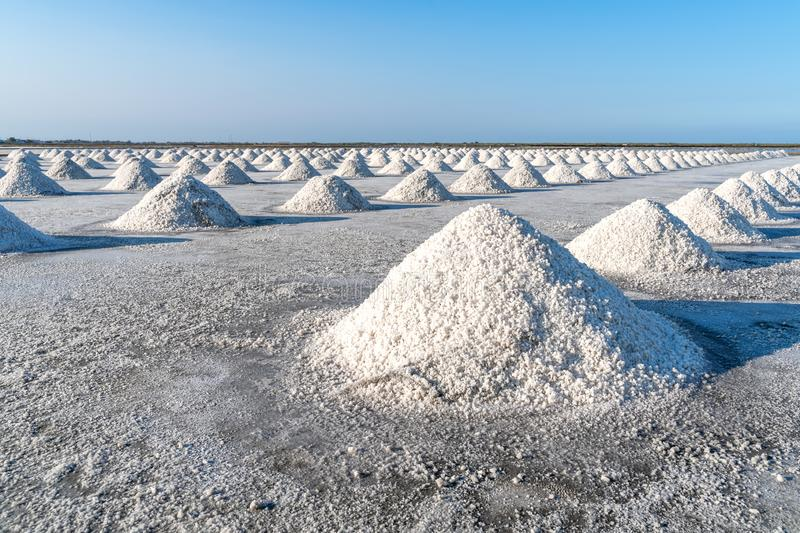 Salt farming using sunlight from the heat,Salt will be gathered together as a pile royalty free stock images