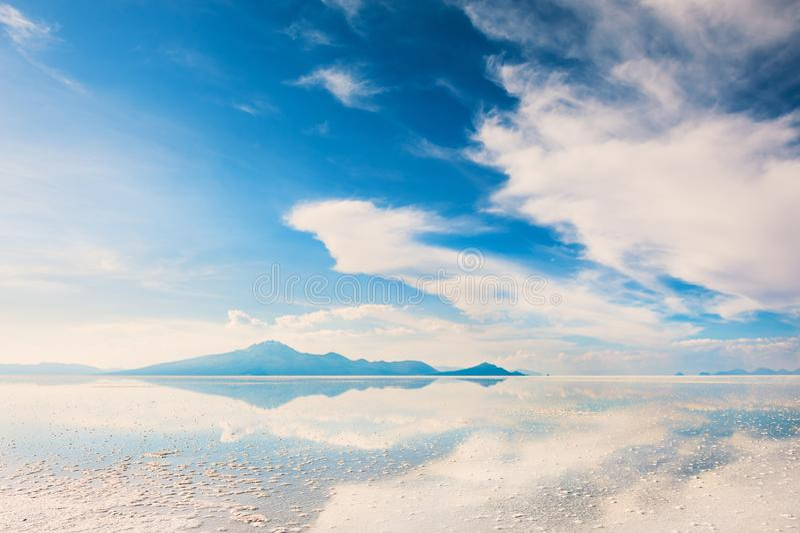 Salt flat Salar de Uyuni, Altiplano, Bolivia. Mirror surface on the salt flat Salar de Uyuni, Altiplano, Bolivia stock image