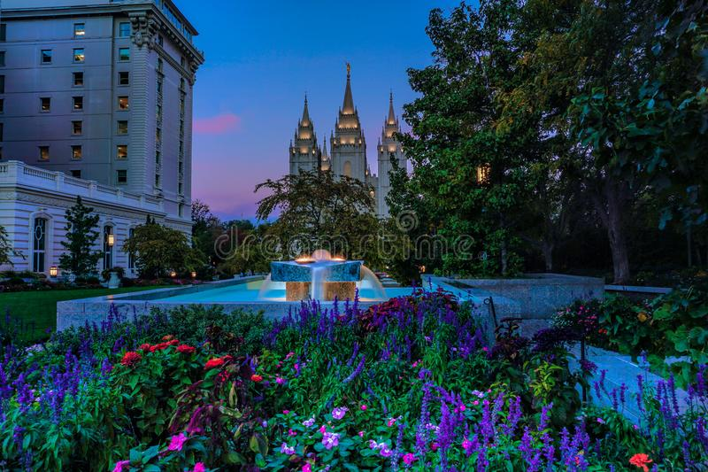 Salt Lake City Temple and fountain at dawn. Salt Lake City Temple with gardens and fountain at dawn in the summer stock image