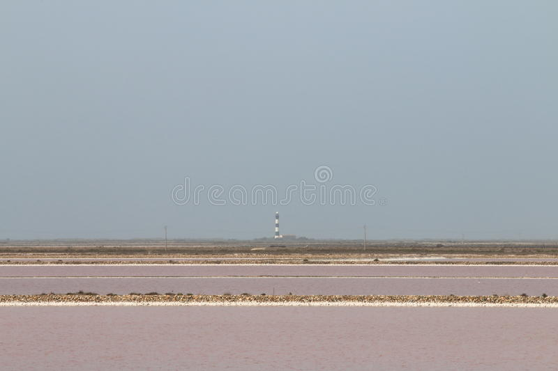 Salt lakes and Faraman Lighthouse, Camargue, France royalty free stock photography