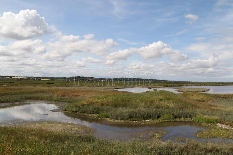 Salt marshes at Cley. Looking across the salt marshes to the sea.NWT Cley Marshes is Norfolk Wildlife Trust's oldest and best known nature reserve. It was stock photos