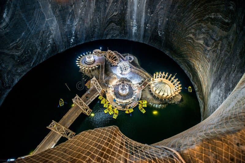 Salt Mine in Turda, Romania. TURDA, ROMANIA - JUNE 30 2015: Underground lake in the Salt Mine Salina Turda museum in Romania royalty free stock images